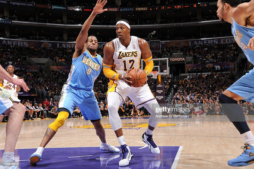 Dwight Howard #12 of the Los Angeles Lakers looks to drive to the basket against the Denver Nuggets at Staples Center on January 6, 2013 in Los Angeles, California.