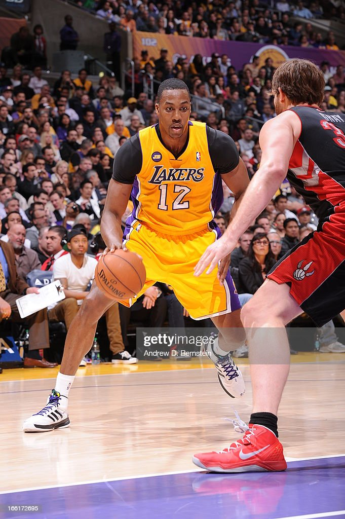 <a gi-track='captionPersonalityLinkClicked' href=/galleries/search?phrase=Dwight+Howard&family=editorial&specificpeople=201570 ng-click='$event.stopPropagation()'>Dwight Howard</a> #12 of the Los Angeles Lakers looks to drive to the basket against the Toronto Raptors at Staples Center on March 8, 2013 in Los Angeles, California.