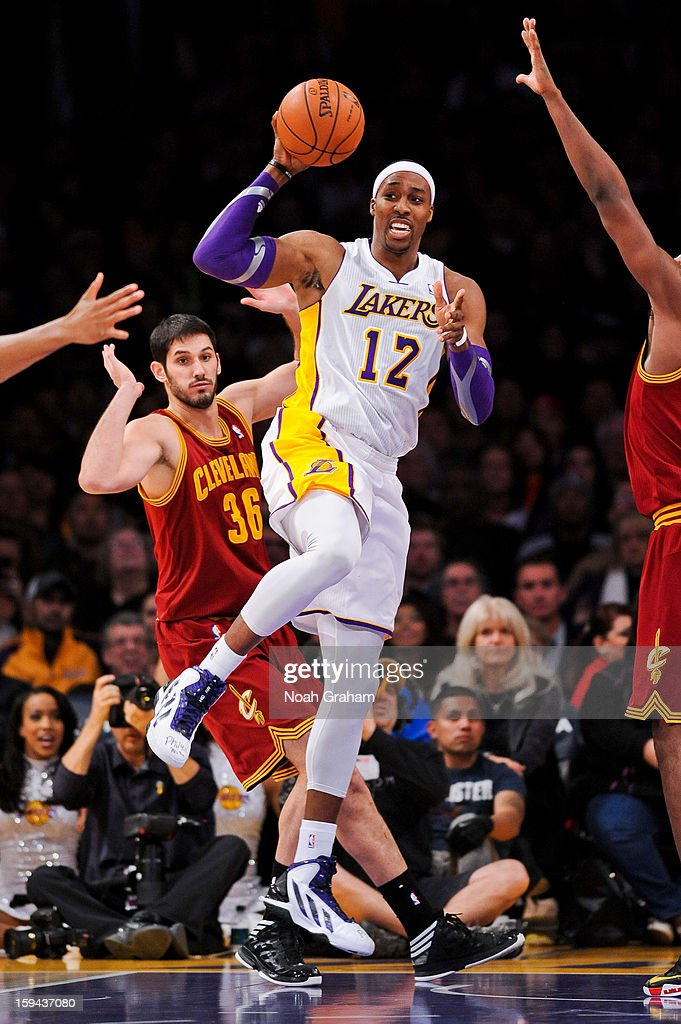 Dwight Howard #12 of the Los Angeles Lakers looks to pass the ball against Omri Casspi #36 of the Cleveland Cavaliers at Staples Center on January 13, 2013 in Los Angeles, California.