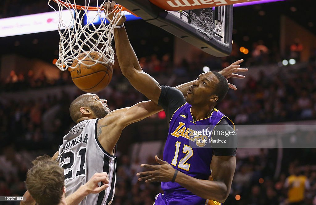 <a gi-track='captionPersonalityLinkClicked' href=/galleries/search?phrase=Dwight+Howard&family=editorial&specificpeople=201570 ng-click='$event.stopPropagation()'>Dwight Howard</a> #12 of the Los Angeles Lakers makes the dunk against <a gi-track='captionPersonalityLinkClicked' href=/galleries/search?phrase=Tim+Duncan&family=editorial&specificpeople=201467 ng-click='$event.stopPropagation()'>Tim Duncan</a> #21 of the San Antonio Spurs during Game Two of the Western Conference Quarterfinals of the 2013 NBA Playoffs at AT&T Center on April 24, 2013 in San Antonio, Texas.