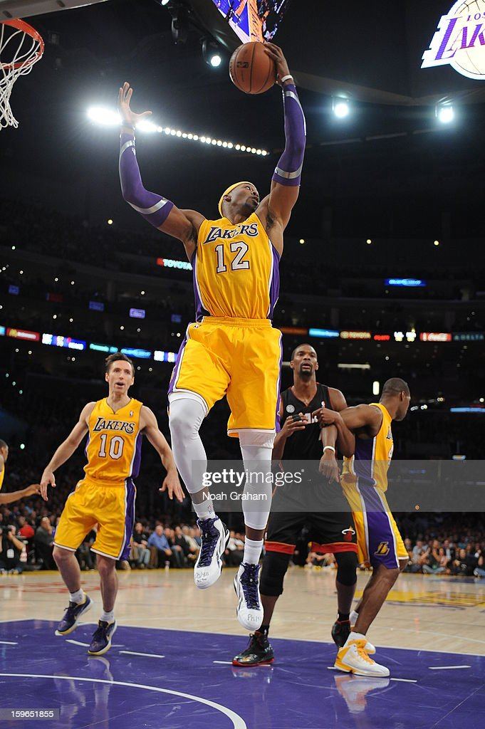 Dwight Howard #12 of the Los Angeles Lakers pulls down a rebound against the Miami Heat at Staples Center on January 15, 2013 in Los Angeles, California.