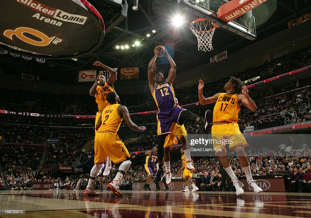Dwight Howard #12 of the Los Angeles Lakers pulls down the rebound against Kyrie Irving #2 and Anderson Varejao #17 of the Cleveland Cavaliers at The Quicken Loans Arena on December 11, 2012 in Cleveland, Ohio.