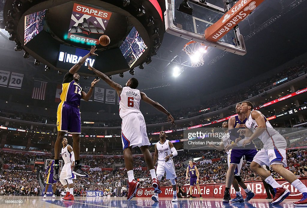 <a gi-track='captionPersonalityLinkClicked' href=/galleries/search?phrase=Dwight+Howard&family=editorial&specificpeople=201570 ng-click='$event.stopPropagation()'>Dwight Howard</a> #12 of the Los Angeles Lakers puts up a shot over <a gi-track='captionPersonalityLinkClicked' href=/galleries/search?phrase=DeAndre+Jordan&family=editorial&specificpeople=4665718 ng-click='$event.stopPropagation()'>DeAndre Jordan</a> #6 of the Los Angeles Clippers during the first half of the NBA game at Staples Center on April 7, 2013 in Los Angeles, California.