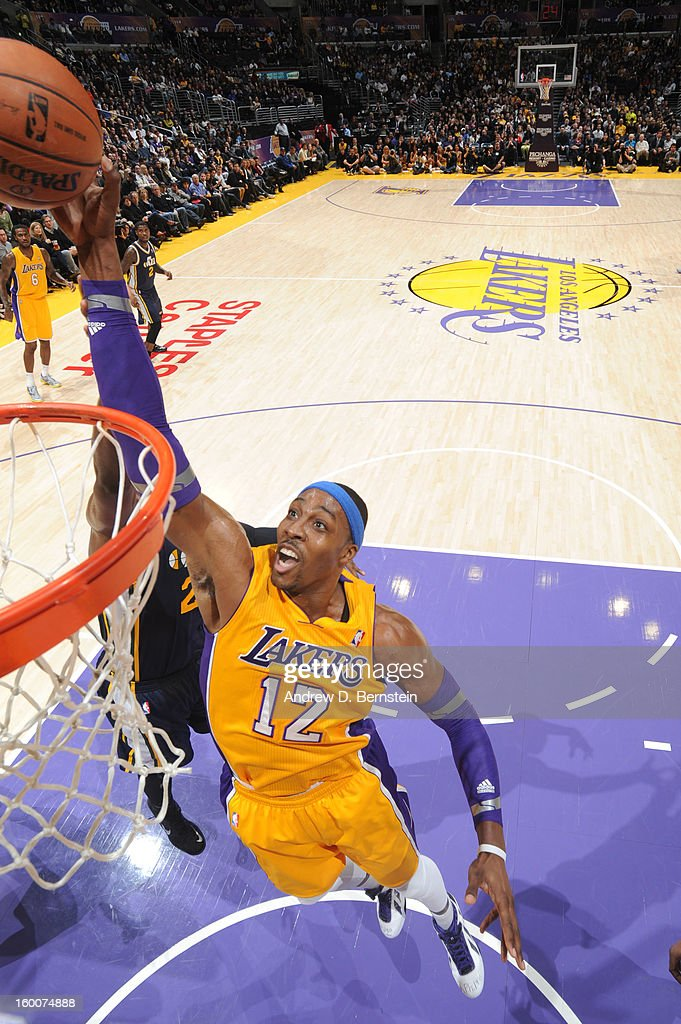 Dwight Howard #12 of the Los Angeles Lakers reaches for a rebound against the Utah Jazz at Staples Center on January 25, 2013 in Los Angeles, California.