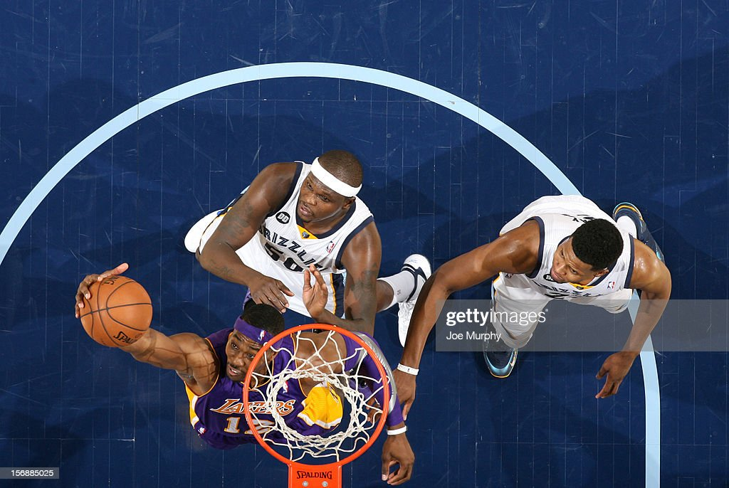 <a gi-track='captionPersonalityLinkClicked' href=/galleries/search?phrase=Dwight+Howard&family=editorial&specificpeople=201570 ng-click='$event.stopPropagation()'>Dwight Howard</a> #12 of the Los Angeles Lakers rebounds against <a gi-track='captionPersonalityLinkClicked' href=/galleries/search?phrase=Zach+Randolph&family=editorial&specificpeople=201595 ng-click='$event.stopPropagation()'>Zach Randolph</a> #50 and <a gi-track='captionPersonalityLinkClicked' href=/galleries/search?phrase=Rudy+Gay&family=editorial&specificpeople=236066 ng-click='$event.stopPropagation()'>Rudy Gay</a> #22 of the Memphis Grizzlies on November 23, 2012 at FedExForum in Memphis, Tennessee.