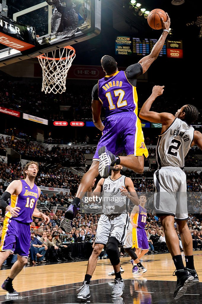 Dwight Howard #12 of the Los Angeles Lakers rises for a dunk against Kawhi Leonard #2 of the San Antonio Spurs in Game Two of the Western Conference Quarterfinals during the 2013 NBA Playoffs on April 24, 2013 at the AT&T Center in San Antonio, Texas.