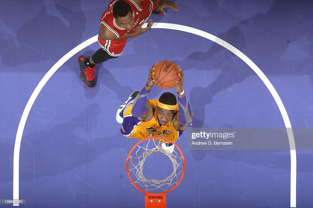 Dwight Howard #12 of the Los Angeles Lakers rises for a dunk against the Milwaukee Bucks at Staples Center on January 15, 2013 in Los Angeles, California.