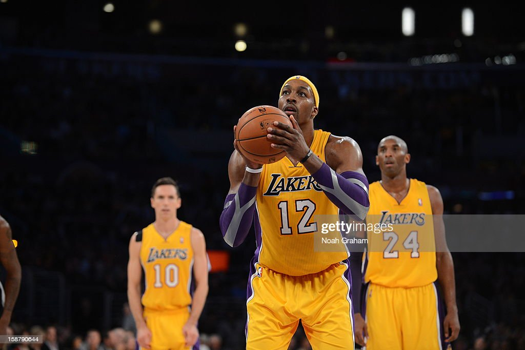 <a gi-track='captionPersonalityLinkClicked' href=/galleries/search?phrase=Dwight+Howard&family=editorial&specificpeople=201570 ng-click='$event.stopPropagation()'>Dwight Howard</a> #12 of the Los Angeles Lakers shoots a free throw while teammate <a gi-track='captionPersonalityLinkClicked' href=/galleries/search?phrase=Steve+Nash+-+Basketball+Player&family=editorial&specificpeople=201513 ng-click='$event.stopPropagation()'>Steve Nash</a> #10 and <a gi-track='captionPersonalityLinkClicked' href=/galleries/search?phrase=Kobe+Bryant&family=editorial&specificpeople=201466 ng-click='$event.stopPropagation()'>Kobe Bryant</a> #24 look on during the game against the Portland Trail Blazers at Staples Center on December 28, 2012 in Los Angeles, California.