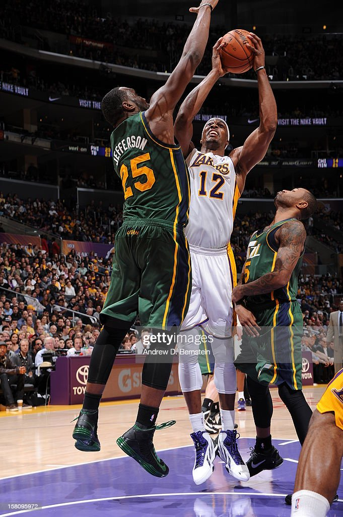 Dwight Howard #12 of the Los Angeles Lakers shoots against Al Jefferson #25 of the Utah Jazz at Staples Center on December 9, 2012 in Los Angeles, California.