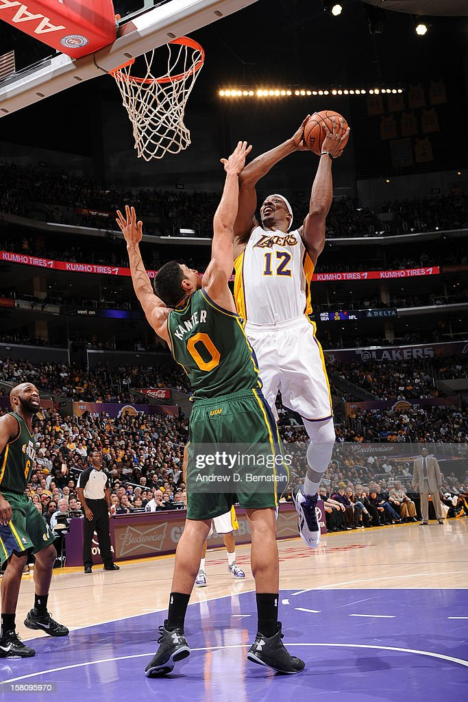 <a gi-track='captionPersonalityLinkClicked' href=/galleries/search?phrase=Dwight+Howard&family=editorial&specificpeople=201570 ng-click='$event.stopPropagation()'>Dwight Howard</a> #12 of the Los Angeles Lakers shoots against <a gi-track='captionPersonalityLinkClicked' href=/galleries/search?phrase=Enes+Kanter&family=editorial&specificpeople=5621416 ng-click='$event.stopPropagation()'>Enes Kanter</a> #0 of the Utah Jazz at Staples Center on December 9, 2012 in Los Angeles, California.