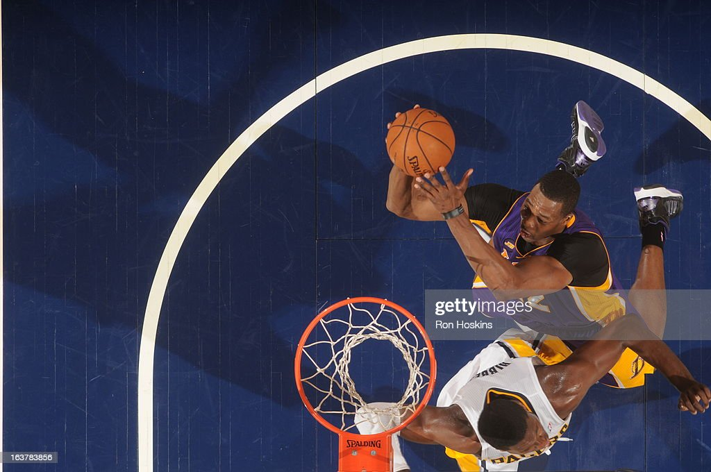 <a gi-track='captionPersonalityLinkClicked' href=/galleries/search?phrase=Dwight+Howard&family=editorial&specificpeople=201570 ng-click='$event.stopPropagation()'>Dwight Howard</a> #12 of the Los Angeles Lakers shoots against <a gi-track='captionPersonalityLinkClicked' href=/galleries/search?phrase=Roy+Hibbert&family=editorial&specificpeople=725128 ng-click='$event.stopPropagation()'>Roy Hibbert</a> #55 of the Indiana Pacers on March 15, 2013 at Bankers Life Fieldhouse in Indianapolis, Indiana.