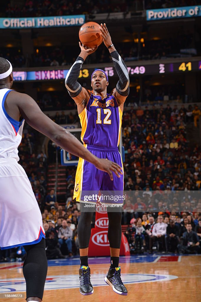 Dwight Howard #12 of the Los Angeles Lakers shoots against the Philadelphia 76ers on December 16, 2012 at the Wells Fargo Center in Philadelphia, Pennsylvania.