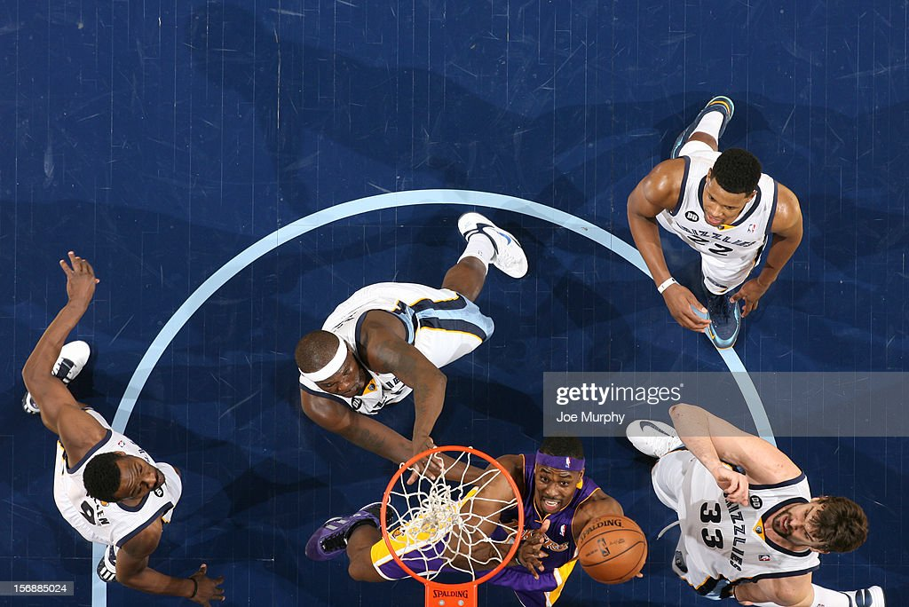 <a gi-track='captionPersonalityLinkClicked' href=/galleries/search?phrase=Dwight+Howard&family=editorial&specificpeople=201570 ng-click='$event.stopPropagation()'>Dwight Howard</a> #12 of the Los Angeles Lakers shoots against <a gi-track='captionPersonalityLinkClicked' href=/galleries/search?phrase=Tony+Allen+-+Joueur+de+basketball&family=editorial&specificpeople=201665 ng-click='$event.stopPropagation()'>Tony Allen</a> #9, <a gi-track='captionPersonalityLinkClicked' href=/galleries/search?phrase=Zach+Randolph&family=editorial&specificpeople=201595 ng-click='$event.stopPropagation()'>Zach Randolph</a> #50, <a gi-track='captionPersonalityLinkClicked' href=/galleries/search?phrase=Rudy+Gay&family=editorial&specificpeople=236066 ng-click='$event.stopPropagation()'>Rudy Gay</a> #22, and <a gi-track='captionPersonalityLinkClicked' href=/galleries/search?phrase=Marc+Gasol&family=editorial&specificpeople=661205 ng-click='$event.stopPropagation()'>Marc Gasol</a> #33 of the Memphis Grizzlies on November 23, 2012 at FedExForum in Memphis, Tennessee.