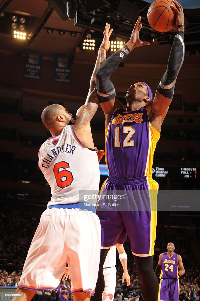 Dwight Howard #12 of the Los Angeles Lakers shoots against Tyson Chandler #6 of the New York Knicks on December 13, 2012 at Madison Square Garden in New York City.