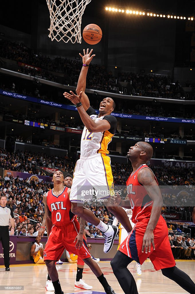 Dwight Howard #12 of the Los Angeles Lakers shoots in the lane against Jeff Teague #0 of the Atlanta Hawks at Staples Center on March 3, 2013 in Los Angeles, California.