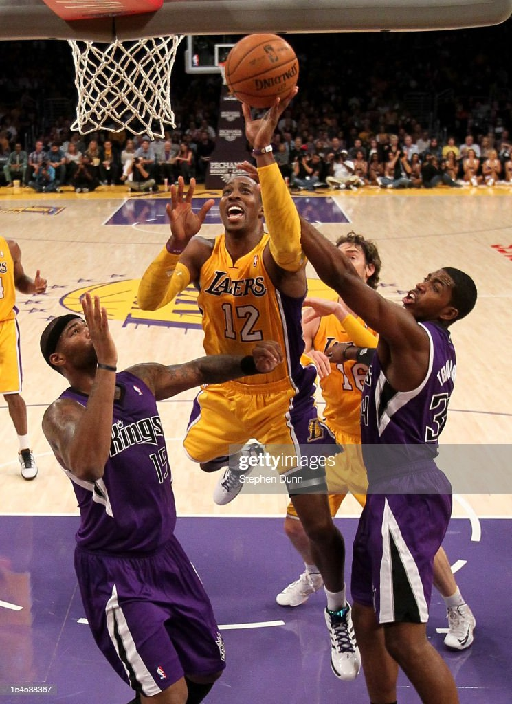 <a gi-track='captionPersonalityLinkClicked' href=/galleries/search?phrase=Dwight+Howard&family=editorial&specificpeople=201570 ng-click='$event.stopPropagation()'>Dwight Howard</a> #12 of the Los Angeles Lakers shoots over <a gi-track='captionPersonalityLinkClicked' href=/galleries/search?phrase=DeMarcus+Cousins&family=editorial&specificpeople=5792008 ng-click='$event.stopPropagation()'>DeMarcus Cousins</a> #15 and Jason Thompson #34 of the Sacramento Kings at Staples Center on October 21, 2012 in Los Angeles, California.