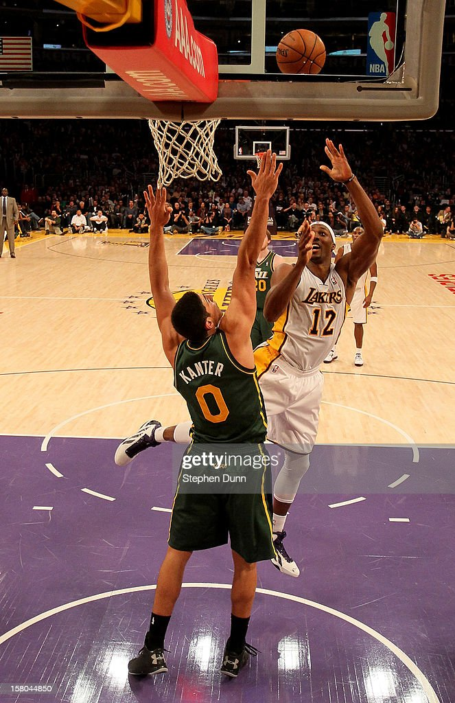 Dwight Howard #12 of the Los Angeles Lakers shoots over Enes Kanter #0 of the Utah Jazz at Staples Center on December 9, 2012 in Los Angeles, California. The Jazz won 117-110.