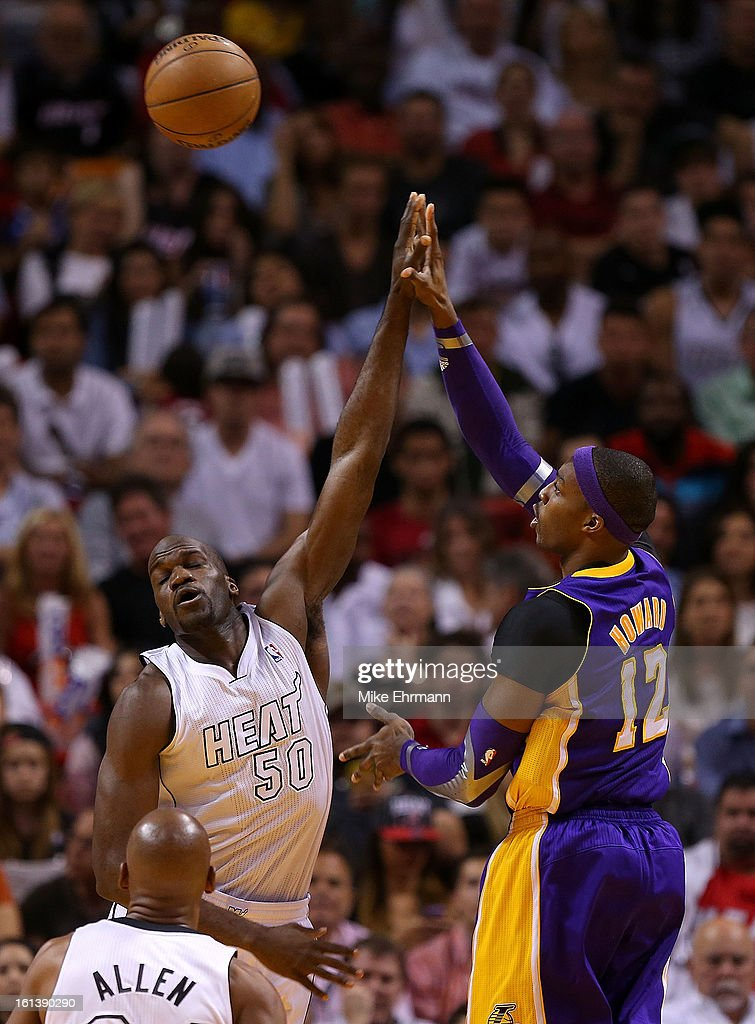 Dwight Howard #12 of the Los Angeles Lakers shoots over Joel Anthony #50 of the Miami Heat during a game at American Airlines Arena on February 10, 2013 in Miami, Florida.