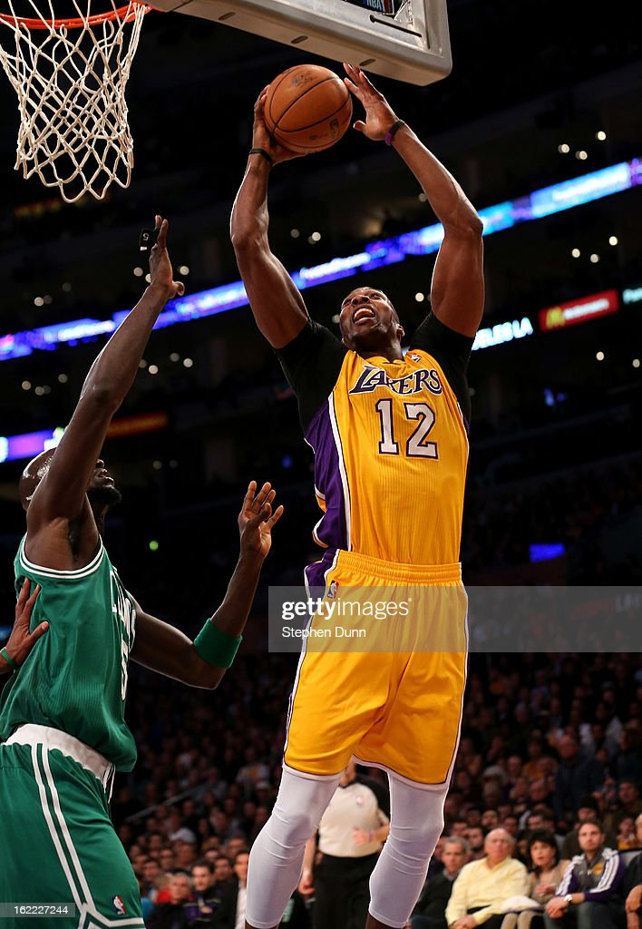 Dwight Howard #12 of the Los Angeles Lakers shoots over Kevin Garnett #5 of the Boston Celtics at Staples Center on February 20, 2013 in Los Angeles, California. The Lakers won 113-99.