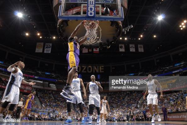 Dwight Howard of the Los Angeles Lakers slamdunks the ball against the Orlando Magic during the game on March 12 2013 at Amway Center in Orlando...
