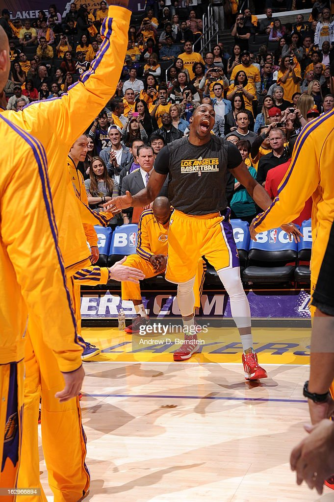<a gi-track='captionPersonalityLinkClicked' href=/galleries/search?phrase=Dwight+Howard&family=editorial&specificpeople=201570 ng-click='$event.stopPropagation()'>Dwight Howard</a> #12 of the Los Angeles Lakers smiles as he is introduced prior to the game against the Los Angeles Clippers at Staples Center on February 14, 2013 in Los Angeles, California.