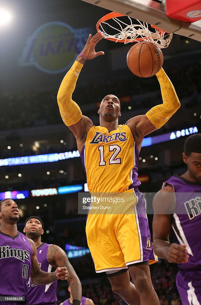 <a gi-track='captionPersonalityLinkClicked' href=/galleries/search?phrase=Dwight+Howard&family=editorial&specificpeople=201570 ng-click='$event.stopPropagation()'>Dwight Howard</a> #12 of the Los Angeles Lakers sunks against the Sacramento Kings at Staples Center on October 21, 2012 in Los Angeles, California.