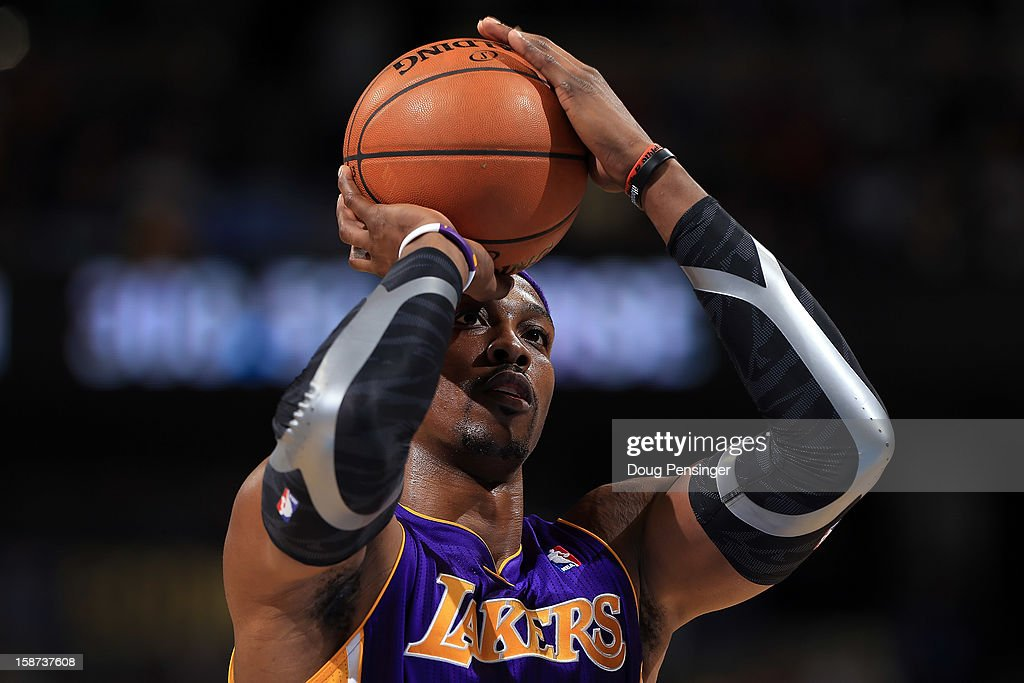 Dwight Howard #12 of the Los Angeles Lakers takes a free throw against the Denver Nuggets at Pepsi Center on December 26, 2012 in Denver, Colorado. The Nuggets defeated the Lakers 126-114.