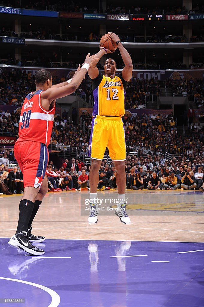 <a gi-track='captionPersonalityLinkClicked' href=/galleries/search?phrase=Dwight+Howard&family=editorial&specificpeople=201570 ng-click='$event.stopPropagation()'>Dwight Howard</a> #12 of the Los Angeles Lakers takes a shot against the Washington Wizards at Staples Center on March 22, 2013 in Los Angeles, California.