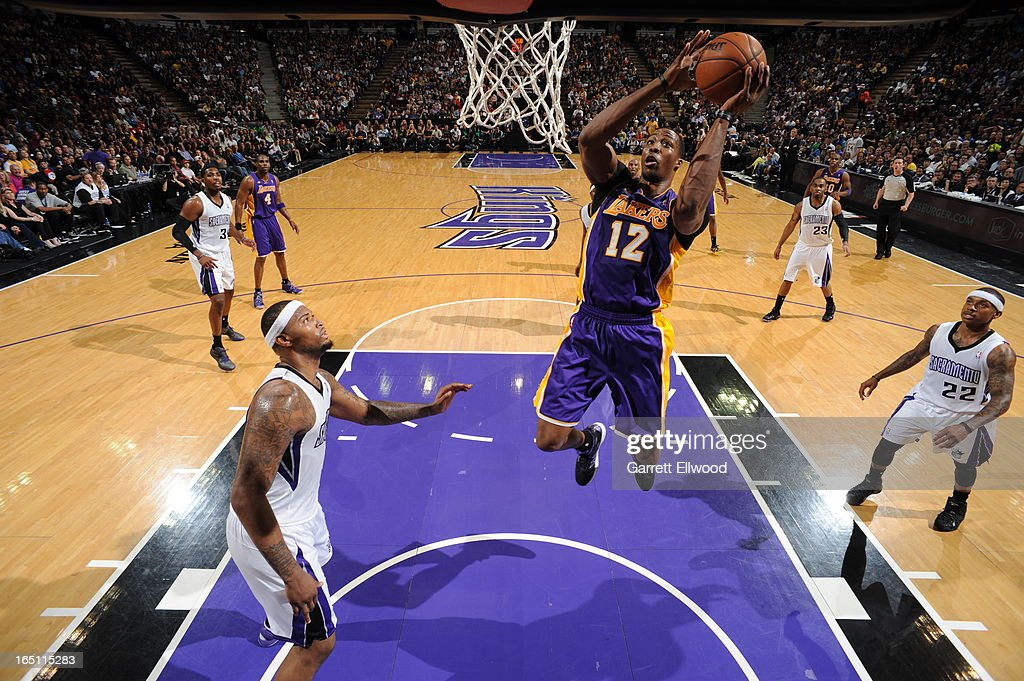 <a gi-track='captionPersonalityLinkClicked' href=/galleries/search?phrase=Dwight+Howard&family=editorial&specificpeople=201570 ng-click='$event.stopPropagation()'>Dwight Howard</a> #12 of the Los Angeles Lakers takes the ball to the basket against <a gi-track='captionPersonalityLinkClicked' href=/galleries/search?phrase=DeMarcus+Cousins&family=editorial&specificpeople=5792008 ng-click='$event.stopPropagation()'>DeMarcus Cousins</a> #15 of the Sacramento Kings on March 30, 2013 at Sleep Train Arena in Sacramento, California.