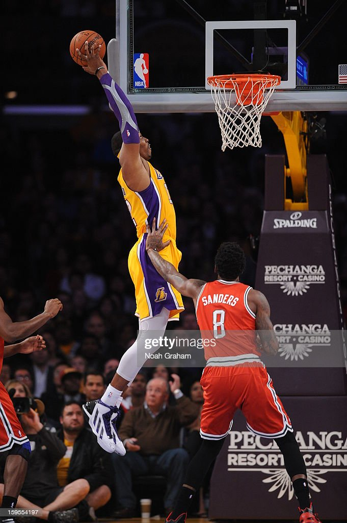 Dwight Howard #12 of the Los Angeles Lakers throws down an alley-oop dunk against Larry Sanders #8 of the Milwaukee Bucks at Staples Center on January 15, 2013 in Los Angeles, California.
