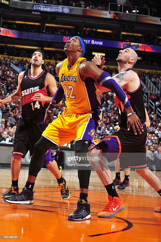 Dwight Howard #12 of the Los Angeles Lakers waits for the rebound against the Phoenix Suns on January 30, 2013 at U.S. Airways Center in Phoenix, Arizona.