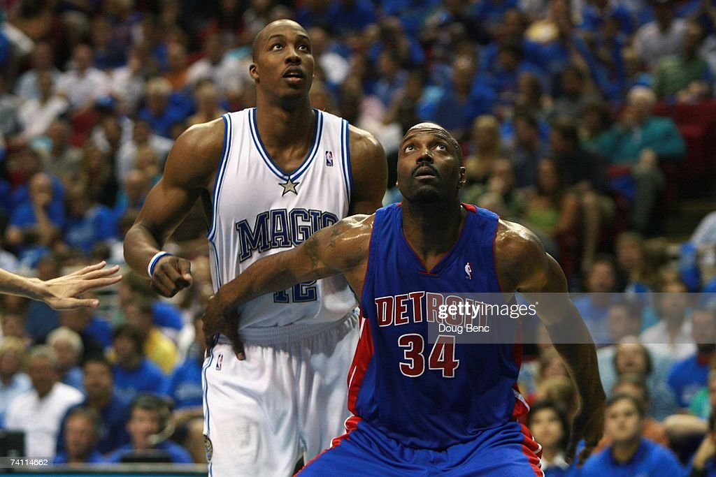 <a gi-track='captionPersonalityLinkClicked' href=/galleries/search?phrase=Dwight+Howard&family=editorial&specificpeople=201570 ng-click='$event.stopPropagation()'>Dwight Howard</a> #12 of the Orlando Magic and Dale Davis #34 of the Detroit Pistons battle for position in Game Three of the Eastern Conference Quarterfinals during the 2007 NBA Playoffs at Amway Arena on April 26, 2007 in Orlando, Florida. The Pistons won 93-77.