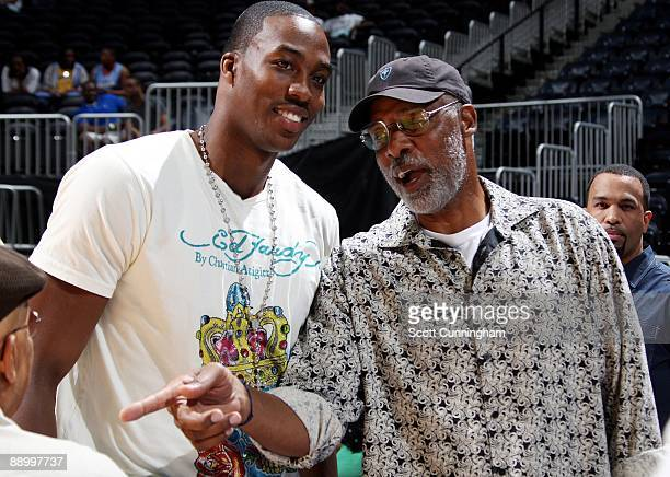 Dwight Howard of the Orlando Magic and Hall of Famer Julius Erving talk prior to the game between the Atlanta Dream and the Detroit Shock at Philips...