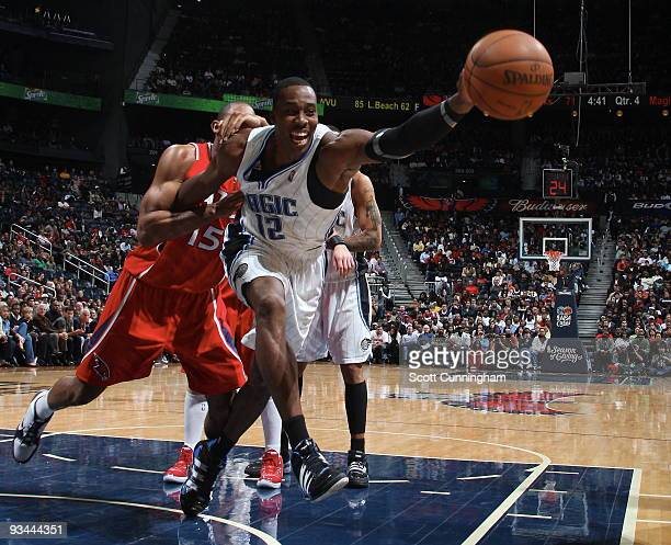 Dwight Howard of the Orlando Magic battles for a loos ball against Al Horford of the Atlanta Hawks on November 26 2009 at Philips Arena in Atlanta...