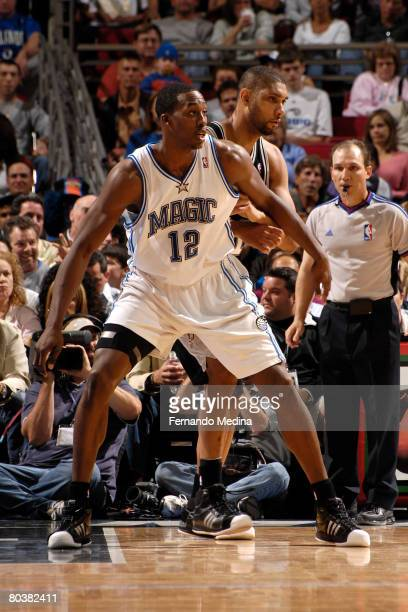 Dwight Howard of the Orlando Magic battles for position with Tim Duncan of the San Antonio Spurs at Amway Arena on March 25 2008 in Orlando Florida...