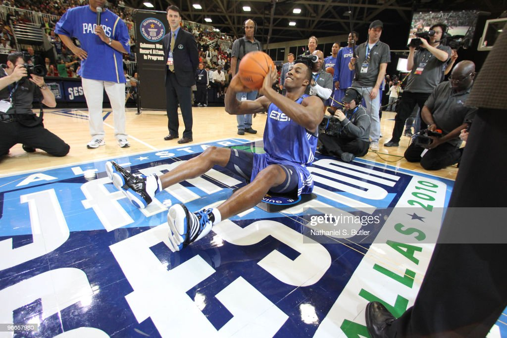 Dwight Howard of the Orlando Magic breaks the Guinness Book of World Record for longest shot sitting down during the East AllStars Practice on center...