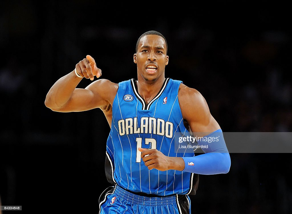 <a gi-track='captionPersonalityLinkClicked' href=/galleries/search?phrase=Dwight+Howard&family=editorial&specificpeople=201570 ng-click='$event.stopPropagation()'>Dwight Howard</a> #12 of the Orlando Magic celebrates during the game against the Los Angeles Lakers at Staples Center on January 16, 2009 in Los Angeles, California.