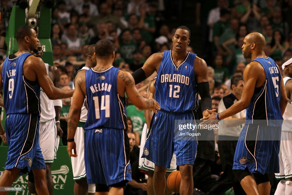 Dwight Howard #12 of the Orlando Magic celebrates with Rashard Lewis #9, Jameer Nelson #14 and Vince Carter #15 after he made a basket in overtime the Boston Celtics in Game Four of the Eastern Conference Finals during the 2010 NBA Playoffs at TD Banknorth Garden on May 24, 2010 in Boston, Massachusetts.