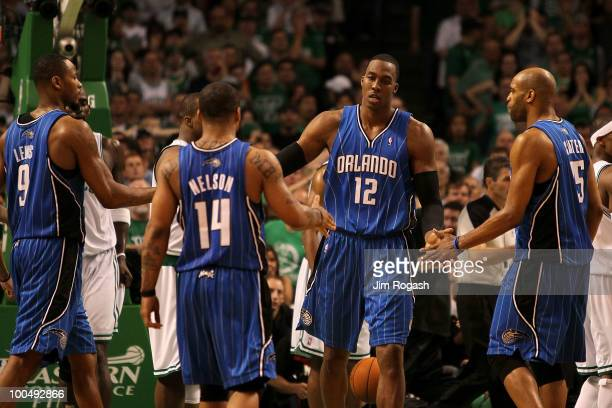 Dwight Howard of the Orlando Magic celebrates with Rashard Lewis Jameer Nelson and Vince Carter after he made a basket in overtime the Boston Celtics...