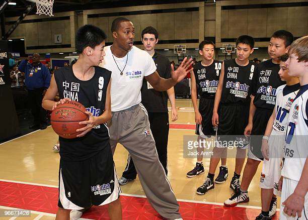 Dwight Howard of the Orlando Magic directs the Jr NBA China Team basketball clinic on the Adidas court during Jam Session presented by Adidas during...