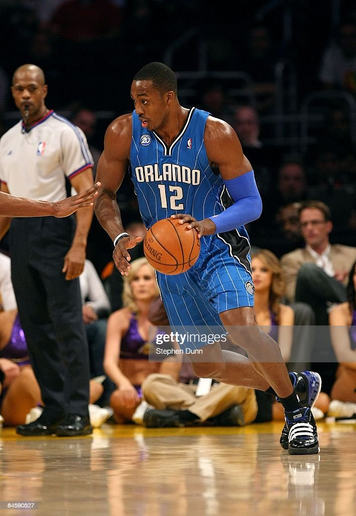 <a gi-track='captionPersonalityLinkClicked' href=/galleries/search?phrase=Dwight+Howard&family=editorial&specificpeople=201570 ng-click='$event.stopPropagation()'>Dwight Howard</a> #12 of the Orlando Magic dribbles the ball to the basket during their NBA game against the Los Angeles Lakers on January 16, 2009 at Staples Center in Los Angeles, California. The Magic won 109-103.