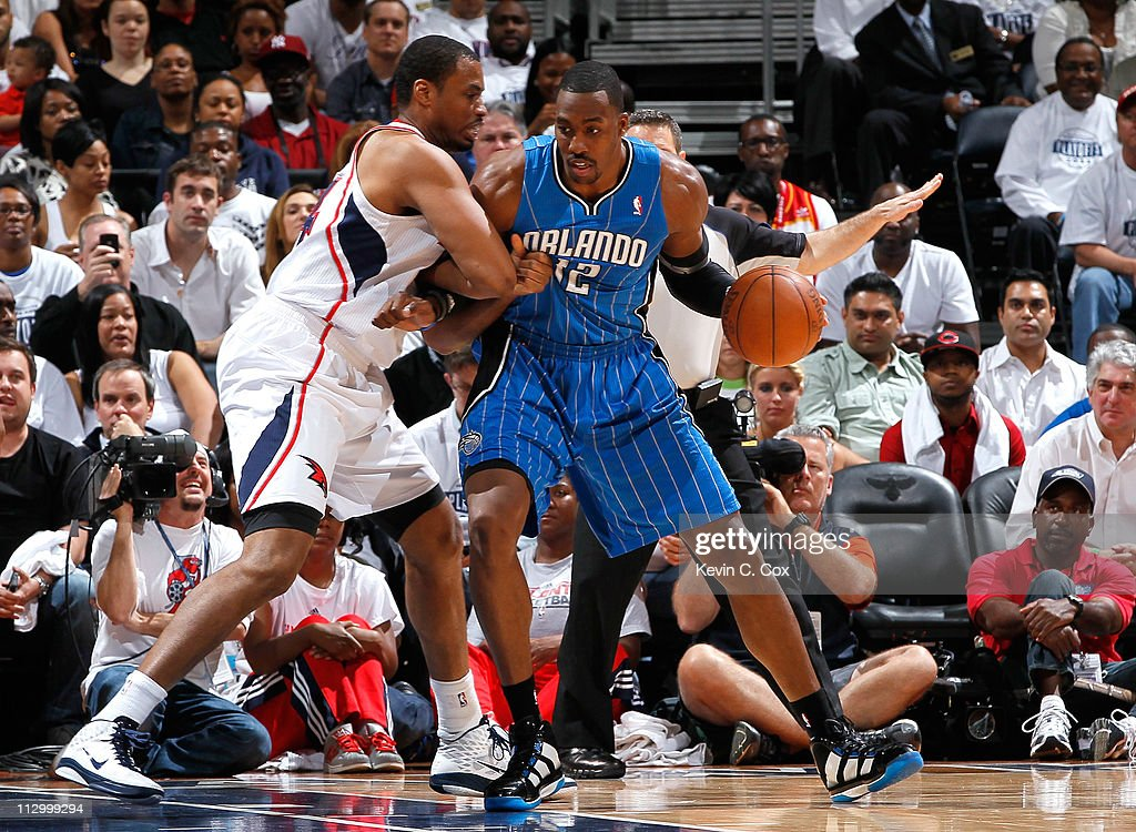 <a gi-track='captionPersonalityLinkClicked' href=/galleries/search?phrase=Dwight+Howard&family=editorial&specificpeople=201570 ng-click='$event.stopPropagation()'>Dwight Howard</a> #12 of the Orlando Magic drives into the basket against <a gi-track='captionPersonalityLinkClicked' href=/galleries/search?phrase=Jason+Collins+-+Basketball+Player&family=editorial&specificpeople=201926 ng-click='$event.stopPropagation()'>Jason Collins</a> #34 of the Atlanta Hawks during Game Three of the Eastern Conference Quarterfinals in the 2011 NBA Playoffs at Philips Arena on April 22, 2011 in Atlanta, Georgia.