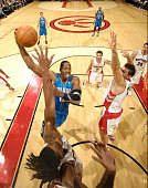 Dwight Howard of the Orlando Magic drives strong to the net between Chris Bosh and Andrea Bargnani of the Toronto Raptors on November 22 2009 at the...