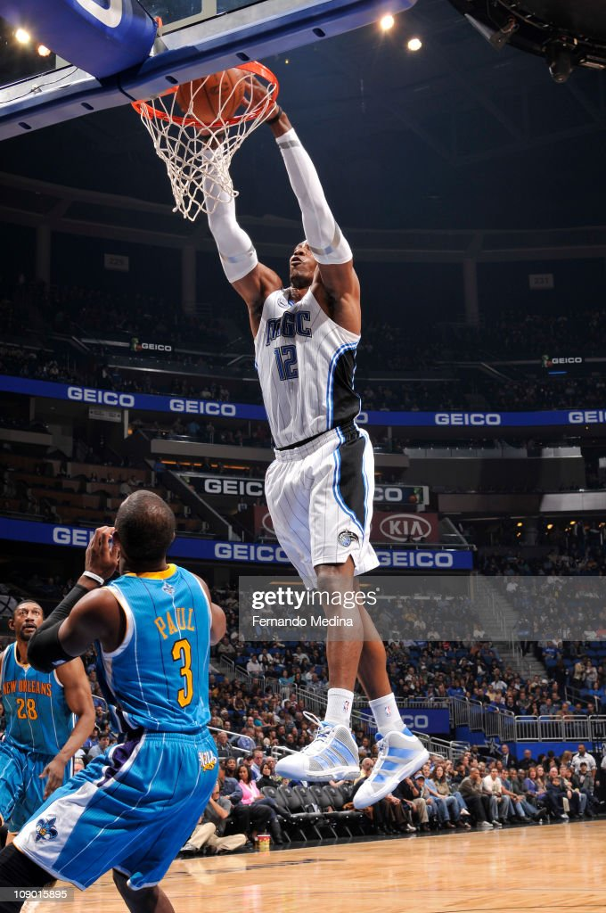 <a gi-track='captionPersonalityLinkClicked' href=/galleries/search?phrase=Dwight+Howard&family=editorial&specificpeople=201570 ng-click='$event.stopPropagation()'>Dwight Howard</a> #12 of the Orlando Magic dunks against <a gi-track='captionPersonalityLinkClicked' href=/galleries/search?phrase=Chris+Paul&family=editorial&specificpeople=212762 ng-click='$event.stopPropagation()'>Chris Paul</a> #3 of the New Orleans Hornets during the game on February 11, 2011 at the Amway Center in Orlando, Florida.