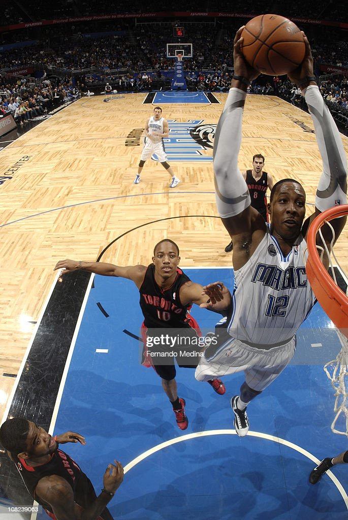 <a gi-track='captionPersonalityLinkClicked' href=/galleries/search?phrase=Dwight+Howard&family=editorial&specificpeople=201570 ng-click='$event.stopPropagation()'>Dwight Howard</a> #12 of the Orlando Magic dunks against DeMar DeRozan #10 of the Toronto Raptors on January 21, 2011 at the Amway Center in Orlando, Florida.
