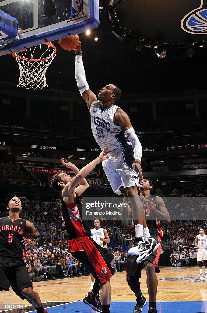 <a gi-track='captionPersonalityLinkClicked' href=/galleries/search?phrase=Dwight+Howard&family=editorial&specificpeople=201570 ng-click='$event.stopPropagation()'>Dwight Howard</a> #12 of the Orlando Magic dunks against Ed Davis #32 and Jose Calderon #8 of the Toronto Raptors on January 21, 2011 at the Amway Center in Orlando, Florida.