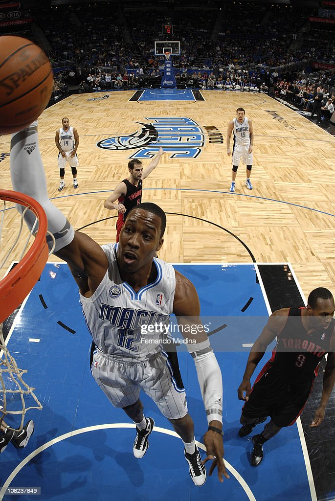 <a gi-track='captionPersonalityLinkClicked' href=/galleries/search?phrase=Dwight+Howard&family=editorial&specificpeople=201570 ng-click='$event.stopPropagation()'>Dwight Howard</a> #12 of the Orlando Magic dunks against <a gi-track='captionPersonalityLinkClicked' href=/galleries/search?phrase=Joey+Dorsey&family=editorial&specificpeople=728526 ng-click='$event.stopPropagation()'>Joey Dorsey</a> #9 of the Toronto Raptors on January 21, 2011 at the Amway Center in Orlando, Florida.
