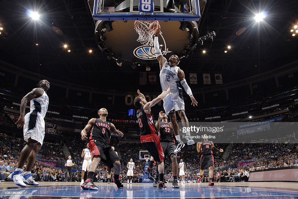 <a gi-track='captionPersonalityLinkClicked' href=/galleries/search?phrase=Dwight+Howard&family=editorial&specificpeople=201570 ng-click='$event.stopPropagation()'>Dwight Howard</a> #12 of the Orlando Magic dunks against Jose Calderon #8 of the Toronto Raptors on January 21, 2011 at the Amway Center in Orlando, Florida.