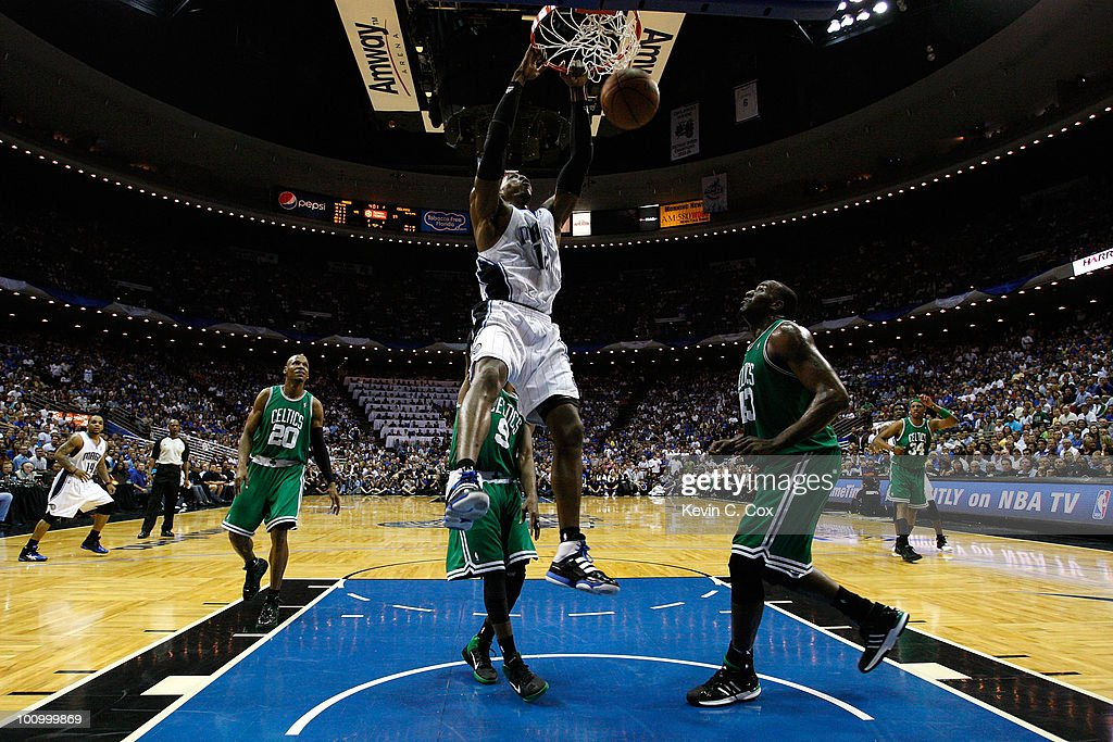 <a gi-track='captionPersonalityLinkClicked' href=/galleries/search?phrase=Dwight+Howard&family=editorial&specificpeople=201570 ng-click='$event.stopPropagation()'>Dwight Howard</a> #12 of the Orlando Magic dunks against Kendrick Perkins #43 of the Boston Celtics in Game Five of the Eastern Conference Finals during the 2010 NBA Playoffs at Amway Arena on May 26, 2010 in Orlando, Florida.