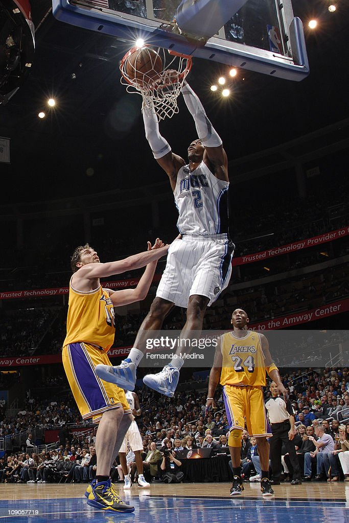 <a gi-track='captionPersonalityLinkClicked' href=/galleries/search?phrase=Dwight+Howard&family=editorial&specificpeople=201570 ng-click='$event.stopPropagation()'>Dwight Howard</a> #12 of the Orlando Magic dunks against <a gi-track='captionPersonalityLinkClicked' href=/galleries/search?phrase=Pau+Gasol&family=editorial&specificpeople=201587 ng-click='$event.stopPropagation()'>Pau Gasol</a> #16 of the Los Angeles Lakers on February 13, 2011 at the Amway Center in Orlando, Florida.